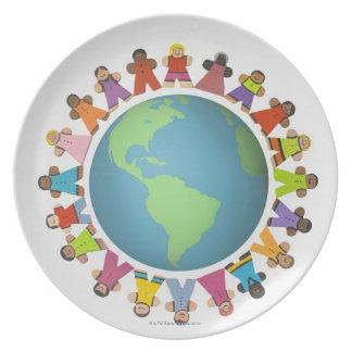 Multi ethnic figurines encircle the globe dinner plates
