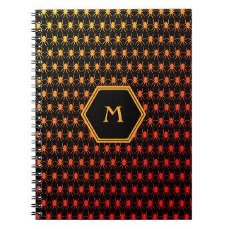 Multi spiders fiery on black Monogram Notebook