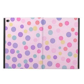 Multicolor confetti dots on pastel pink