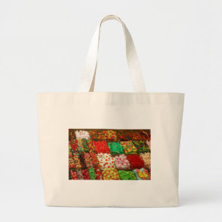 Multicolored-jellies-on-shelfs COLORFUL GUMMY CAND Large Tote Bag