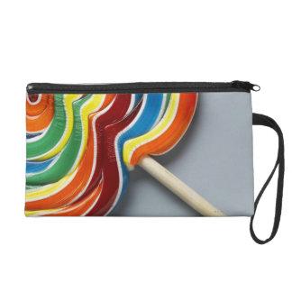 Multicoloured lollipop wristlet clutches