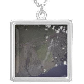 Multiple plumes blow toward the south-southwest square pendant necklace