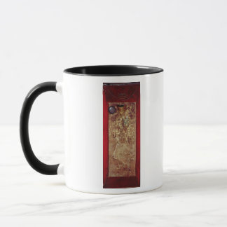 Mummy with gold crown and grave goods mug