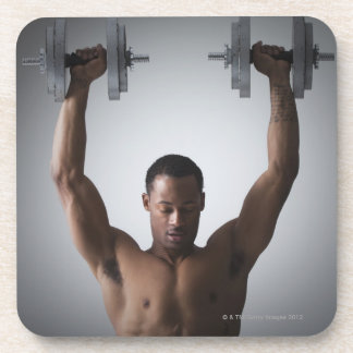 Muscular man lifting dumbbells 2 coaster
