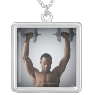 Muscular man lifting dumbbells 2 square pendant necklace