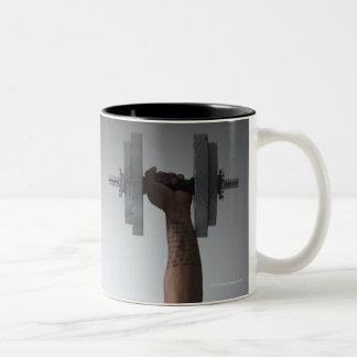Muscular man lifting dumbbells 2 Two-Tone coffee mug