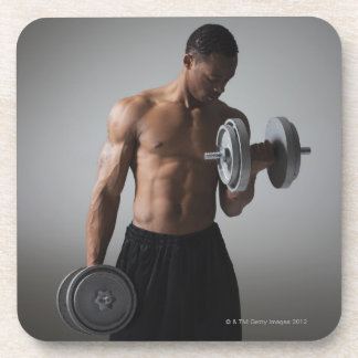 Muscular man lifting dumbbells coaster