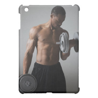 Muscular man lifting dumbbells iPad mini cover