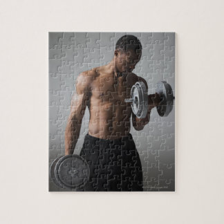 Muscular man lifting dumbbells jigsaw puzzle