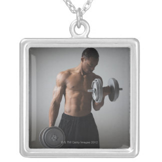 Muscular man lifting dumbbells silver plated necklace