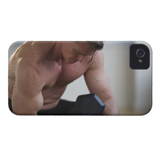 Muscular man lifting free weight iPhone 4 cases