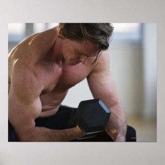 Muscular man lifting free weight poster