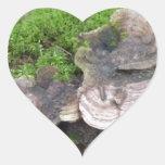 Mushrooms on a tree trunk heart sticker