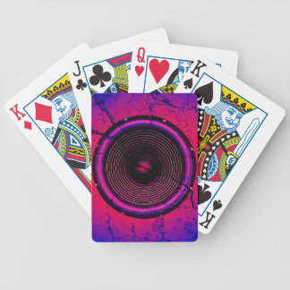 Music speaker on a cracked wall bicycle playing cards