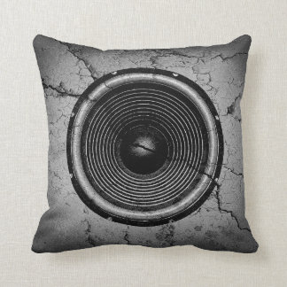 Music speaker on a cracked wall cushion