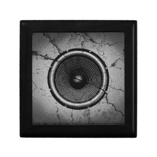 Music speaker on a cracked wall gift box