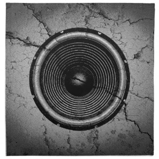 Music speaker on a cracked wall napkin