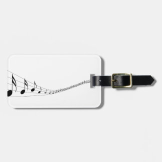 Musical notes on a wave shaped stave bag tag