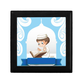 Muslim boy praying at the church small square gift box