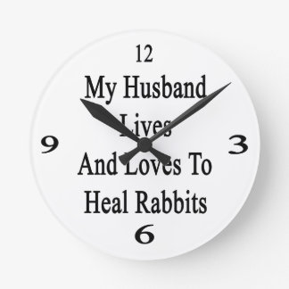 My Husband Lives And Loves To Heal Rabbits Wall Clocks