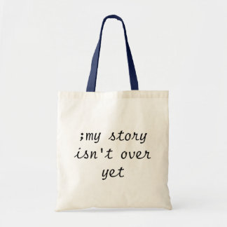 ;my story isn't over yet TOTE BAG