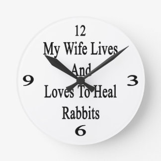 My Wife Lives And Loves To Heal Rabbits Round Wall Clocks