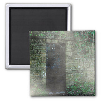 Mysterious doorway in a stone wall square magnet