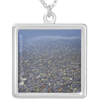 NA, USA, Montana, Glacier NP Rocks in Lake Silver Plated Necklace