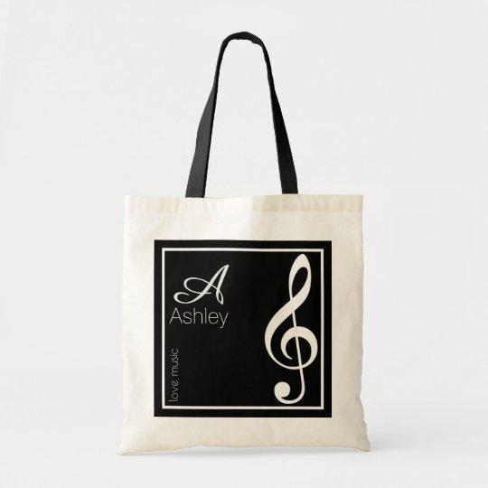 name, initial & white treble clef, music black