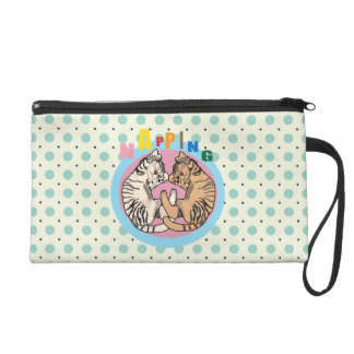 Napping cat wristlet clutches