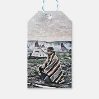 Native American man meditating under first snow Gift Tags