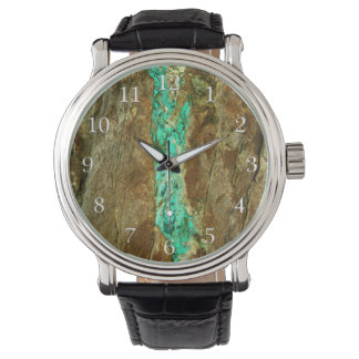 Natural turquoise vein in rough brown stone watch