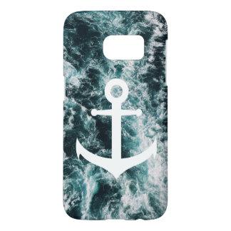 Nautical anchor on ocean photo background