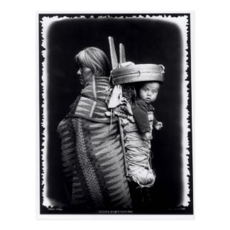 Navaho woman carrying a papoose on her back postcard