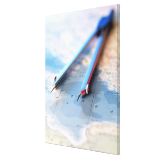 Navigation. Dividers sitting on a map. Canvas Print