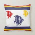 navy blue, yellow, and red fish on white cushion