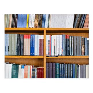 neatly set wooden  bookshelves postcard