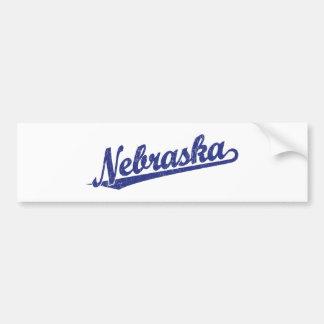 Nebraska script logo in blue distressed bumper sticker