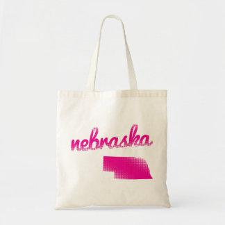 Nebraska state in pink tote bag