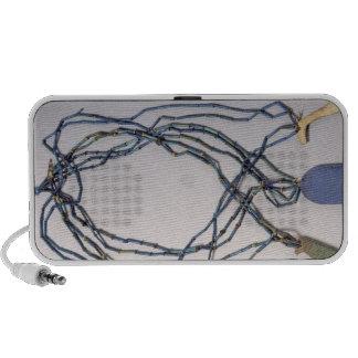 Necklace, found on a mummy laptop speaker