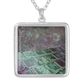 Necklace graphic of keyboard designed with flowers