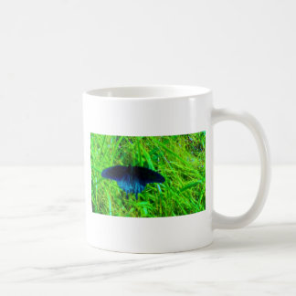 neon blue butterfly  bright green background mug