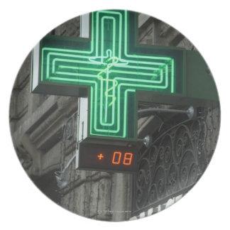 Neon Green cross outside Farmacia (Drug store or Plate