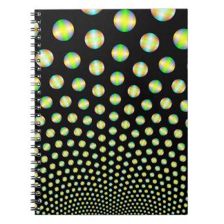 Neon Spheres on Black Notebook