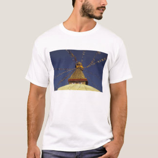 Nepal, Kathmandu. Under prayer flags, watchful T-Shirt