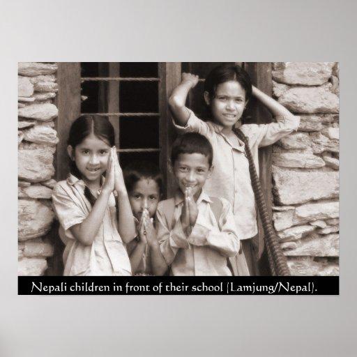 Nepali children in front of their school poster