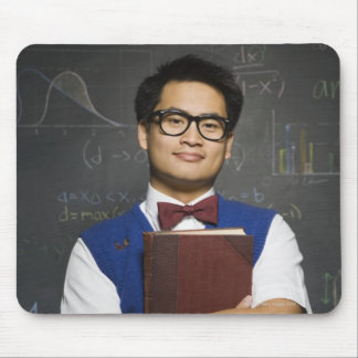 Nerdy Asian male student holding school book Mouse Pad