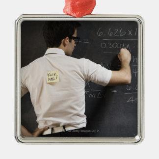 Nerdy man writing on blackboard christmas ornament