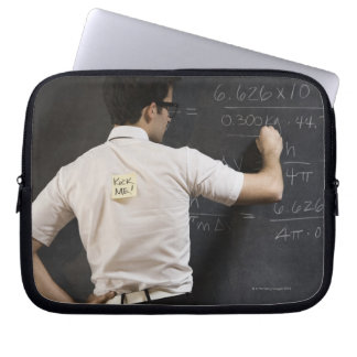 Nerdy man writing on blackboard laptop sleeve