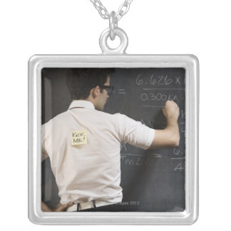 Nerdy man writing on blackboard silver plated necklace